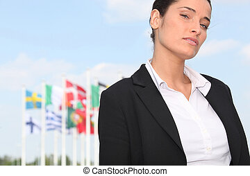 woman standing in front of European flags