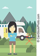 Woman standing in front of motor home. - An asian woman...