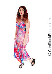 Woman standing in long dress.