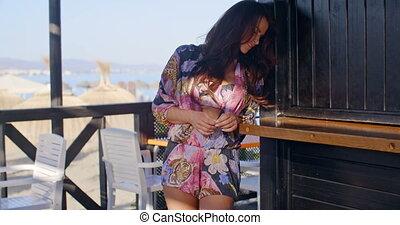 Woman Standing in Shade on Beach Resort Balcony - Three...