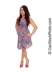 Woman standing in summer dress.