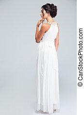 Woman standing in trendy dress