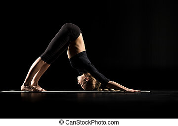 Woman standing in yoga position - Woman performing Adho...