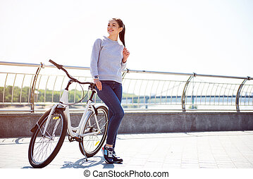 Woman standing near a bike