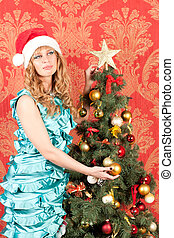 woman standing near a Christmas tree