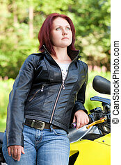 woman standing near bike