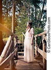 Woman standing on a bridge