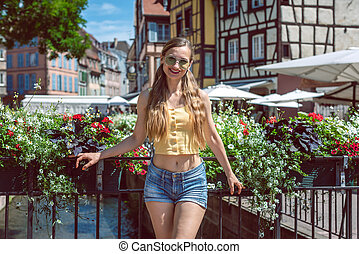 Woman standing on a bridge in Colmar, Alsace, France