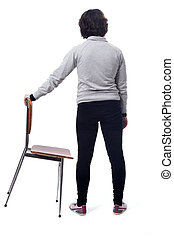 woman standing on a chair with her back on white background