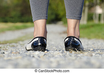Woman standing on a stone road