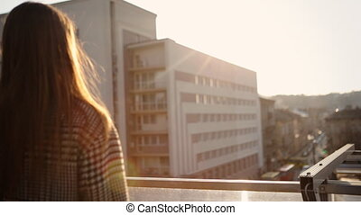 Woman standing on balcony and having relax their.