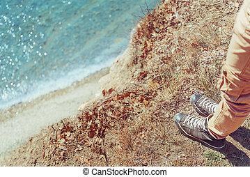 Woman standing on coast