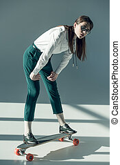 woman standing on skateboard