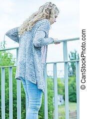 Woman standing on the bridge