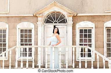 woman standing on the porch