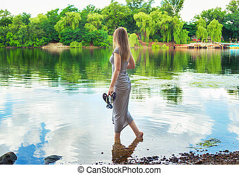 woman standing on the river bank