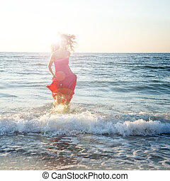 Woman standing on the sea