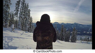 Woman standing on the snow covered landscape 4k - Woman...