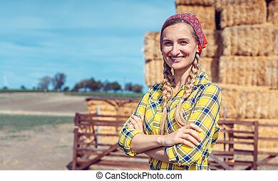 Woman standing proud on her farm