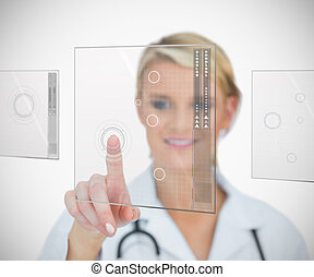 Woman standing touching interface - Woman standing while ...