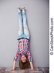 Woman standing upside down