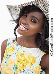 Woman standing wearing a summer hat