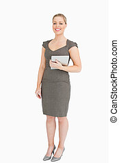 Woman standing while holding an ebook