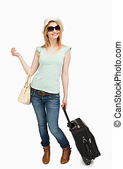 Woman standing while holding baggages