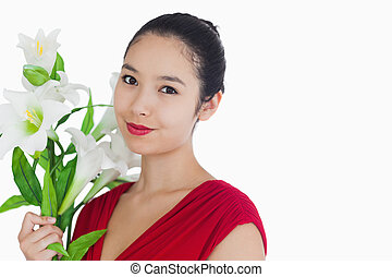 Woman standing while holding flowers