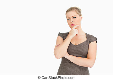 Woman standing while thinking about something