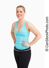 Woman standing while wearing sportswear