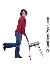 woman standing with a chair in white background
