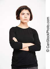 Woman standing with arms folded