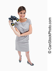 Woman standing with binoculars
