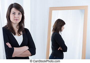 Woman standing with crossed arms