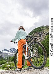 Woman standing with her bike