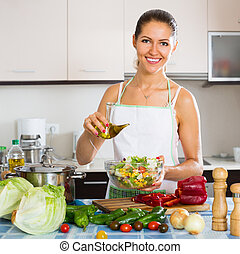 Woman standing with plate of salad