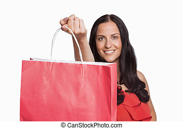 Woman standing with shopping bag
