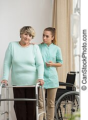 Woman standing with walking frame