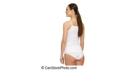 Woman stands backwards - Gorgeous caucasian woman standing...