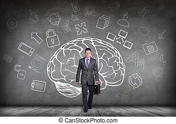 Woman stands beside big drawn brain