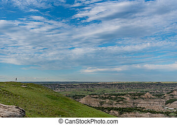 Woman Stands On Horizon Above Theodore Roosevelt National Park