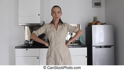 Woman stands pose nods her head - Woman modern kitchen...