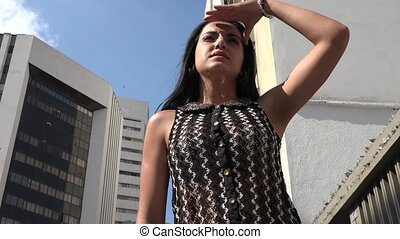Woman Staring in Urban Area
