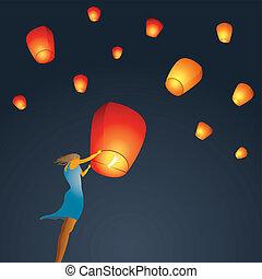 Woman start red Chinese sky lantern - Woman start a red...