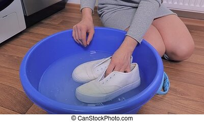 Woman start washing sneakers