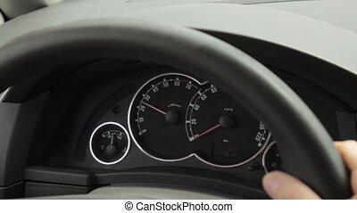Woman starts the engine. tachometer with the pointer going...