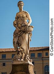 Statue on the bridge of Santa Trinita over the river Arno in Florence, Tuscany, Italy