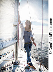 woman staying on sailboat - woman staying on the sailboat...