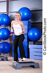 woman stepping in a fitness center